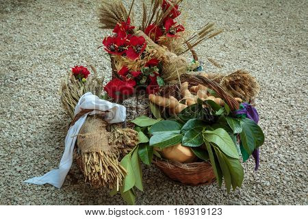 Wicker Baskets Filled With Bread And Sheafs Of Wheat And Red Flowers