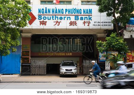 Hanoi, Vietnam - Nov 16, 2014: Front view of Southern Bank branch office on Hang Khay street. Southern Bank is a small local lender bank in Vietnam