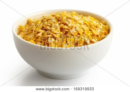 Dry Flaked Corn In White Ceramic Bowl Isolated On White.