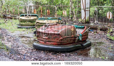 obsolete rusty cars in Pripyat amusement park, Chernobyl