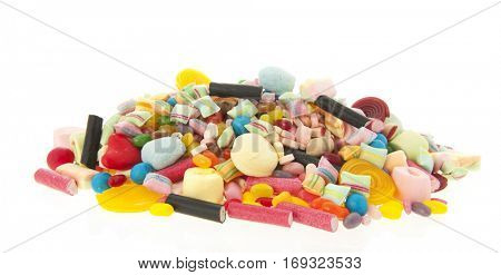 Mixed colorful candy isolated over white background