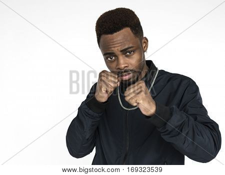 Young black guy fists up ready to fight