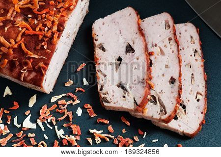 Delicious homemade ham with mushrooms, dried vegetables and paprika closeup