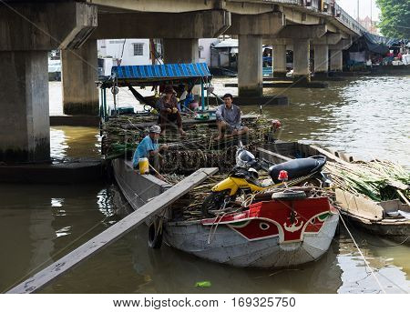 Tien Giang, Vietnam - Nov 28, 2014: Floating boat loaded with sugar cane on sale at Cai Be floating market, one of the busiest market places in Mekong delta