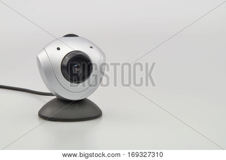 Digital computer webcam with microphone on white background