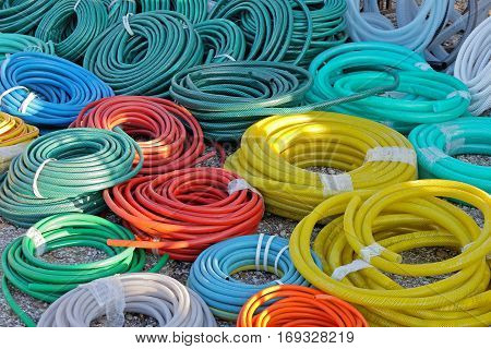 Big Bunch of Garden Hoses in Coils