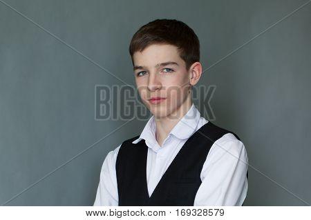 Portrait Of Happy Schoolboy Teenager