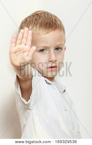 Express negative emotions. Childhood and feelings. Little boy show hand outstretched arm with stop gesture. Hold hand in air.