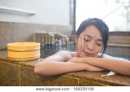 Woman enjoy hot springs in Japanese onsen