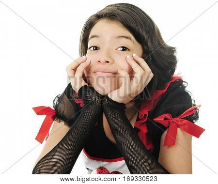 Closeup image of a pretty young teen leaning on her hands while dressed up in red, black and white for Valentine's Day.  On a white background.