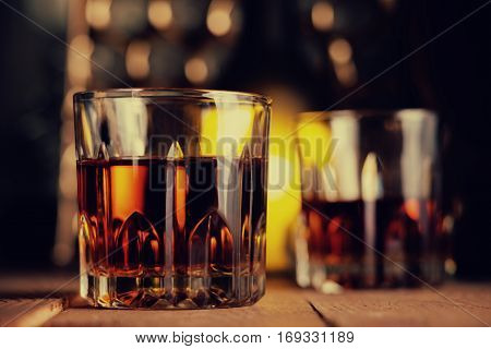 Glass of brandy and spices on the wooden table