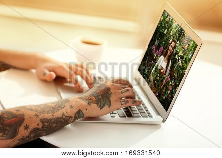 Video call and chat concept. Modern communication technology. Man ordering flowers delivery online via laptop.