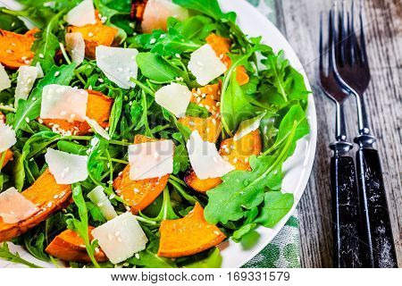 Green Salad With Arugula, Baked Butternut Squash, Parmesan And Sesame