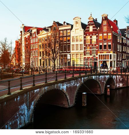 Amsterdam Netherlands canals and bridges. Night view of Keizersgracht and famous touristic place