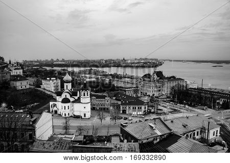 Nizhny Novgorod Russia. Aerial view of illuminated historical buildings at night with river. Black and white