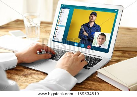 Man video conferencing on laptop. Online car service concept.