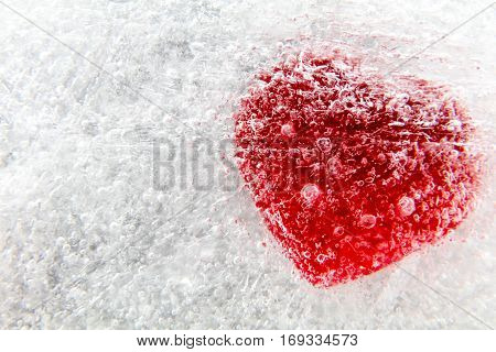 Red heart frozen in ice macro abstract