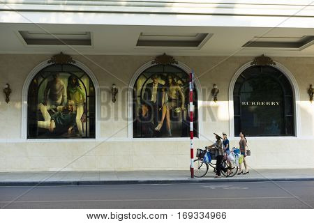 Hanoi, Vietnam - Sept 14, 2014: People moving on street by Trang Tien plaza on Hang Bai street. The plaza is an iconic landmark set at the corner of Hoan Kiem Lake right in the city centre