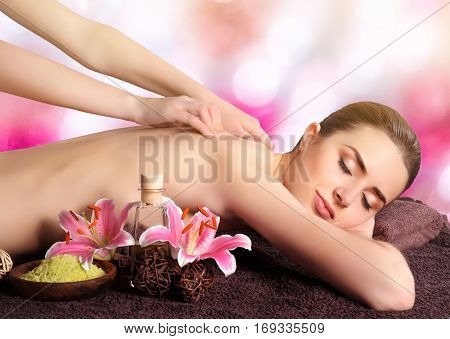 Spa vacations concept. Young woman having massage