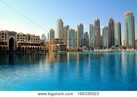 DUBAI UAE - JANUARY 28: Downtown Dubai skyline view from the Dubai fountain on January 28 2017 Dubai UAE.