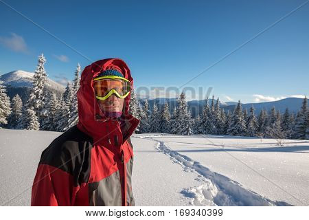 Traveler, Man Wearing A Jacket With A Hood And Goggle Looks At Camera