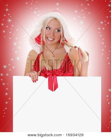 sexy blond mrs. Santa holding white billboard
