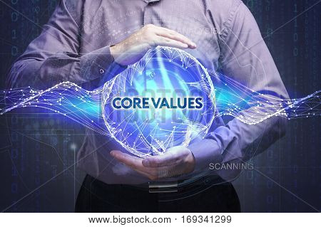 Business, Technology, Internet And Network Concept. Young Businessman Shows The Word: Core Values