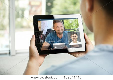 Video conference with financial advisor on tablet. Investment and tax concept.