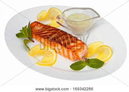 Hot Dish Of Grilled Salmon On Plate With Sauce