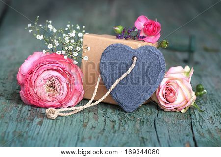 Decoration for a mothers day gift with a slate heart for a loving greeting