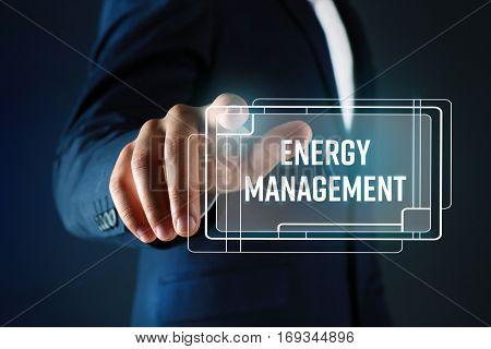 Man pushing ENERGY MANAGEMENT button on virtual screen
