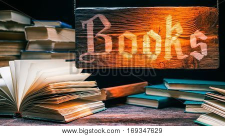 Book store in rustic style. Variety of ancient books. Natural wood showcase