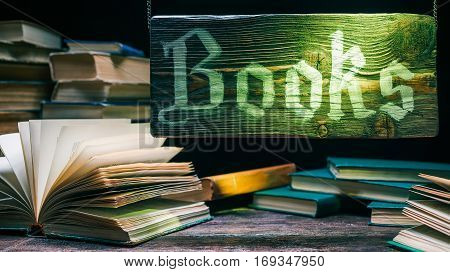 Old book showcase. Wooden sign above assortment of books