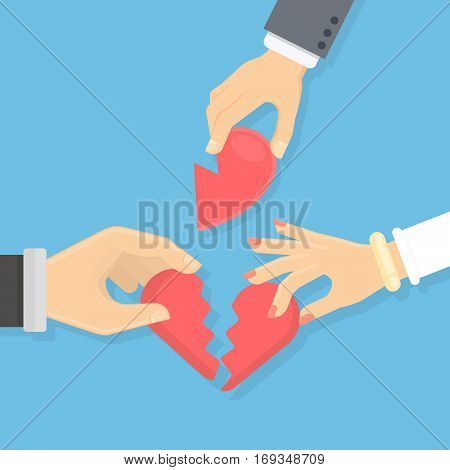 Broken heart concept. Male and female hands hold pieces of broken heart. Idea of divorce, break up and betrayal.