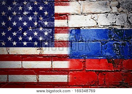 Governments conflict concept. Brick wall colored in USA and Russian flags