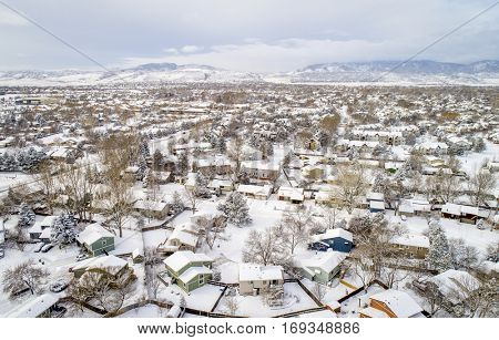aerial  view of typical residential neighborhood along Front Range of Rocky Mountains in Colorado, winter scenery with fresh snow