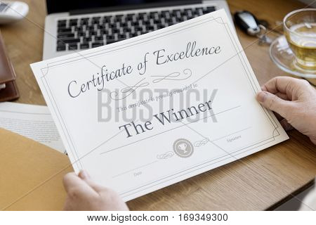 Senior Adult Holding Certificate Concept