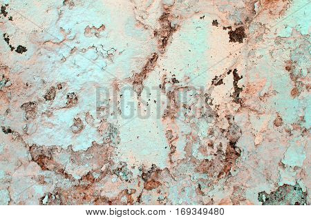 Pastel Colored Damaged Obsolete Cracked Cement Wall Background closeup