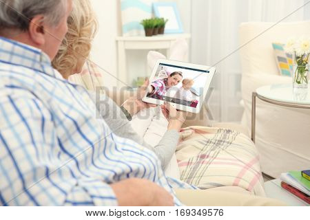 Video call and chat concept. Senior people video conferencing on tablet
