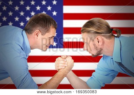 Men arm wrestling on USA flag background