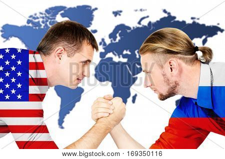 Governments conflict concept. Men arm wrestling on world map background