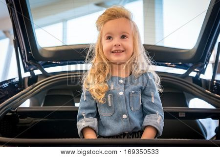 Small Girl In Car Exhibition Room