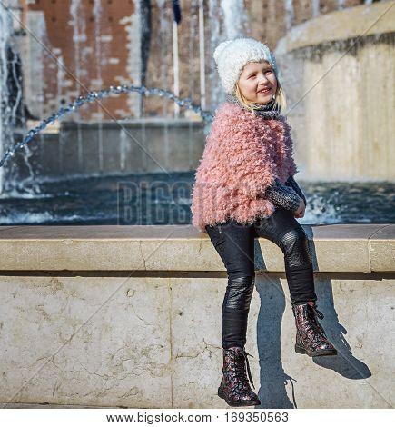 Happy Modern Girl In Milan, Italy Playing Near Fontain