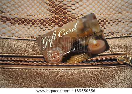 Holiday celebration concept. Spa service gift card in purse pocket