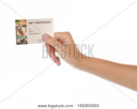 Holiday celebration concept. Female hand with spa service gift certificate on white background