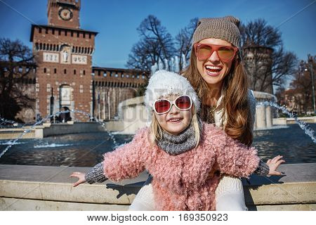 Mother And Daughter Tourists In Milan, Italy Having Fun Time