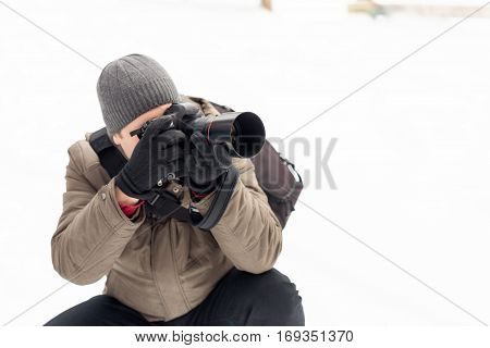 photographer taking pictures in the forest in winter.