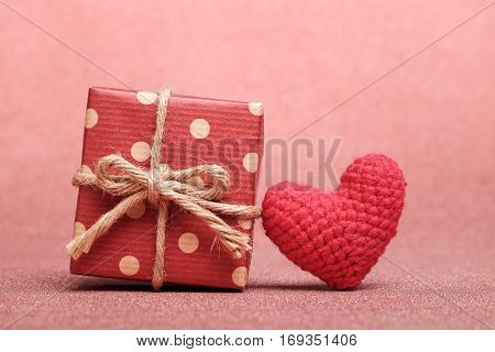 Gift Box And Heart Shaped On Red Background.