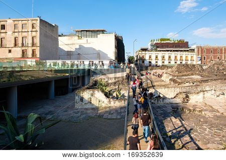 MEXICO CITY,MEXICO - DECEMBER 28,2016 : Visitors at the ruins of the Templo Mayor, one of the main temples of the Aztecs in their capital of Tenochtitlan, which is now Mexico City