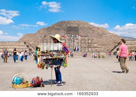 TEOTIHUACAN,MEXICO - DECEMBER 26,2016 : Mexican woman selling typical souvenirs at the Teotihuacan archaeological site near Mexico City